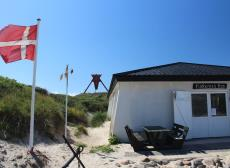 The house of the fishermen 'Fiskernes Hus' and the sea mark by the beach of Blokhus