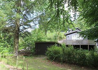 Sommerhus i grønne omgivelser i skoven bag Gistrup