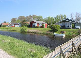 Holiday homes by the stream, behind the beach in the holiday area Varbjerg Strand
