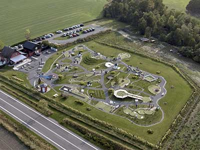 Play mini golf among the cultural sights of Bornholm on the course BornPark near Gudhjem