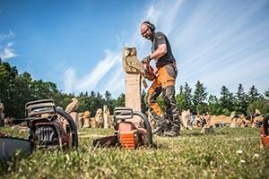 Man creates a wooden sculpture