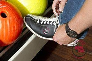 Bowling shoes are being tied
