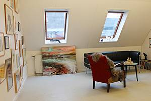 Cosy loft with visual arts and handicraft products