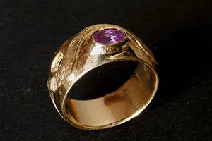 Wave ring with purple stone