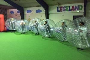 Children wearing inflatable bubble costumes