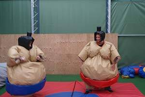 Two persons in inflatable sumo wrestling outfit