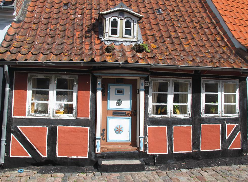 The doll's house, Dukkehuset, in Smedegade in Ærøskøbing is a listed market town house from the 18th century