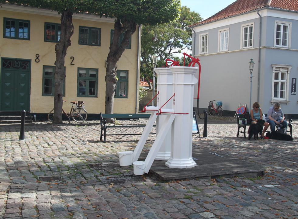 The functional white water pumps on the square in Ærøskøbing