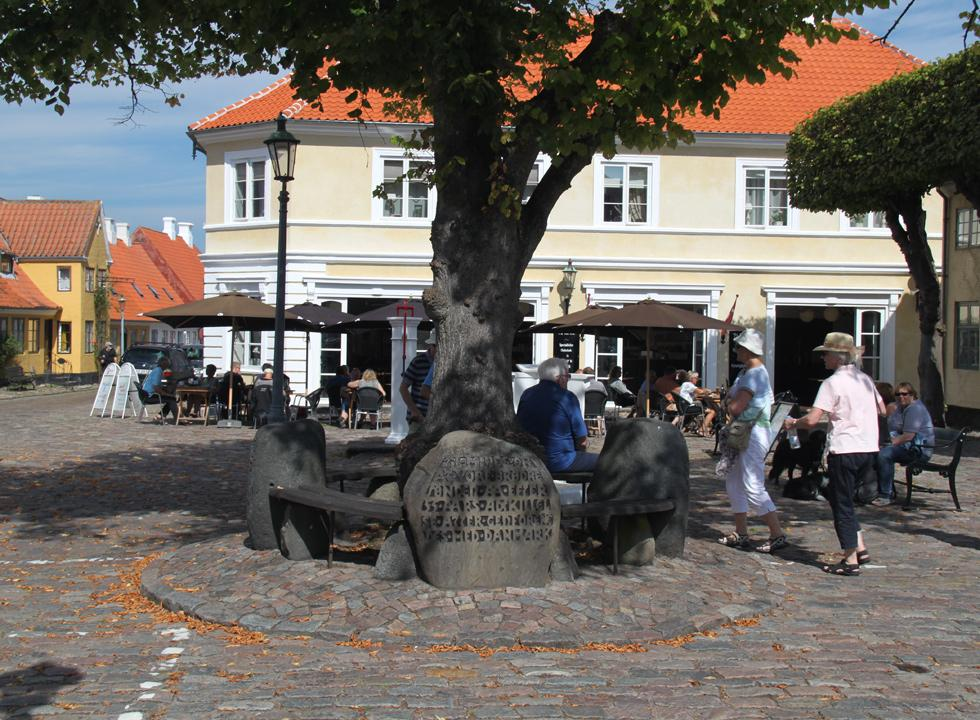 Cosy atmosphere under the large tree on the square in Ærøskøbing