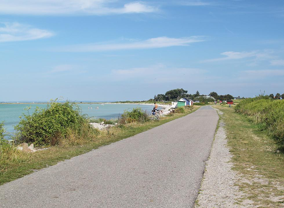 The road, leading to the tongue, Urehoved, takes you past the beach and beach huts of Ærøskøbing