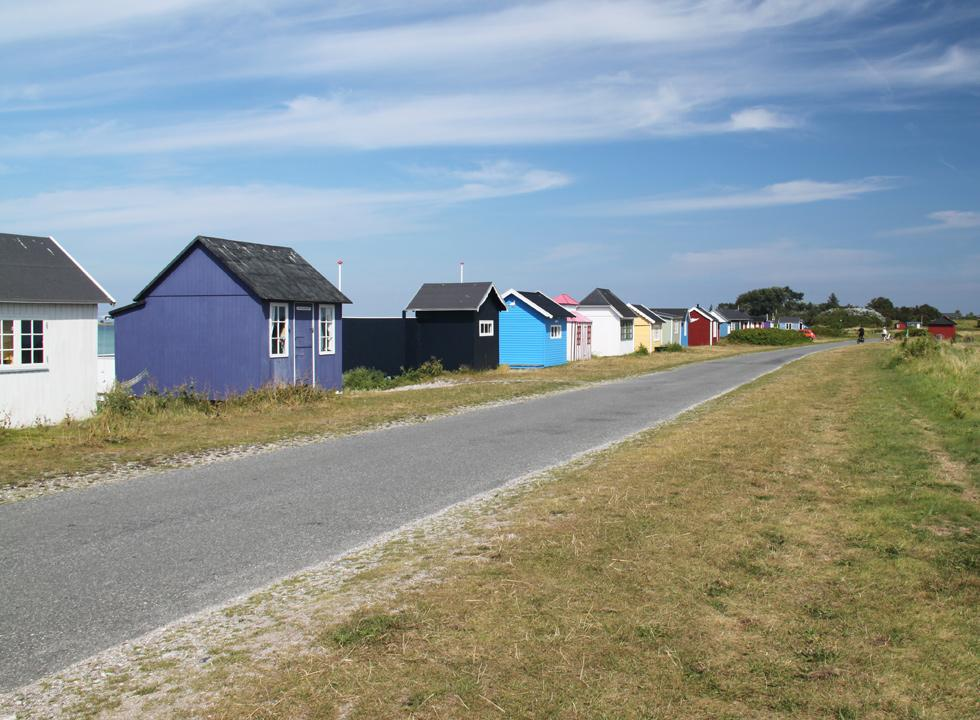 Cosy and colourful beach huts along the beach in Ærøskøbing
