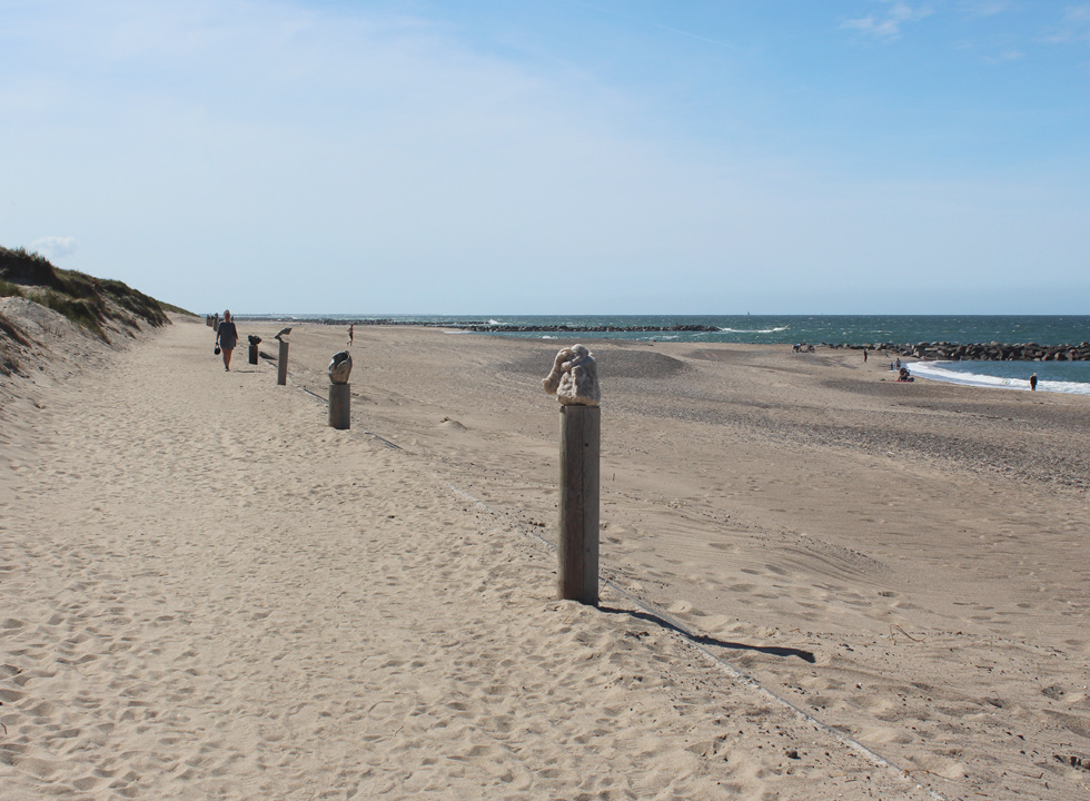 Beautiful sculptures along the dunes on the beach of Agger
