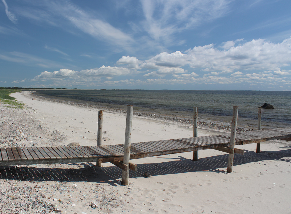 Fine sandy beach with bathing jetty by the holiday home area Amtoft