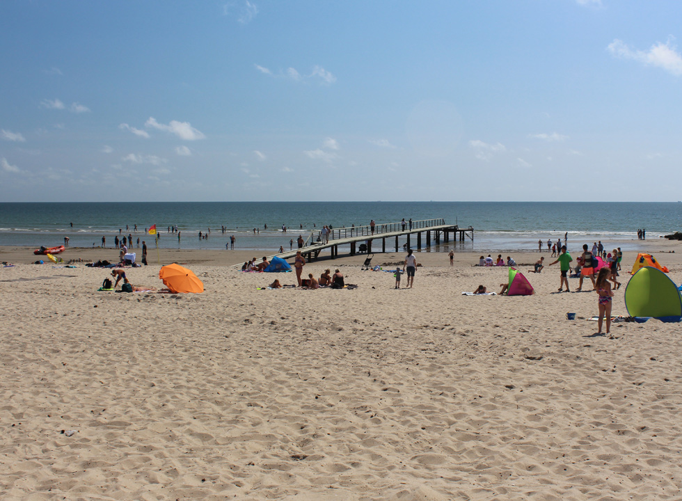 Wooden pier by the popular bathing beach Hvidbjerg Strand in the holiday home area Blaavand