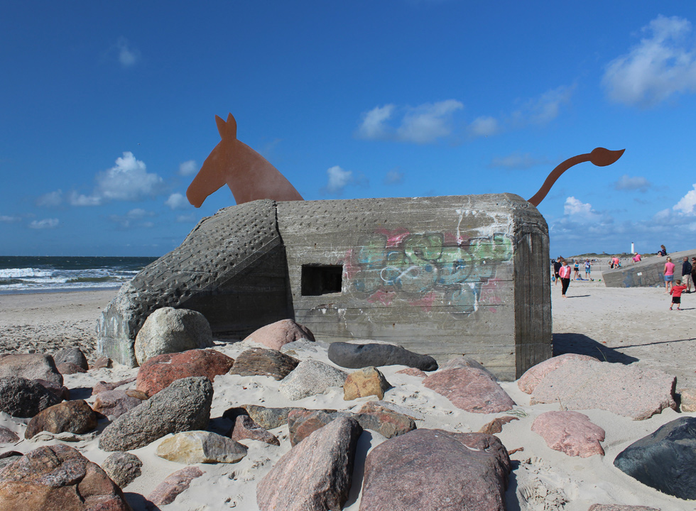 One of the characteristic mule bunkers on the sandy beach in Blaavand