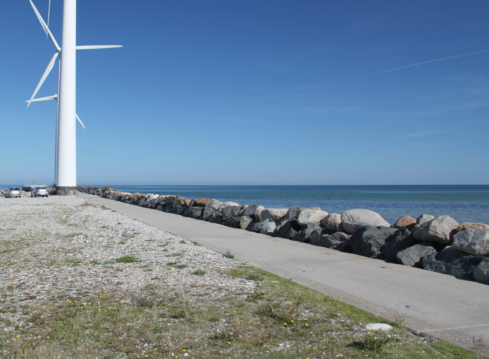 The marina and the beach in Bønnerup is separated by a point with windmills