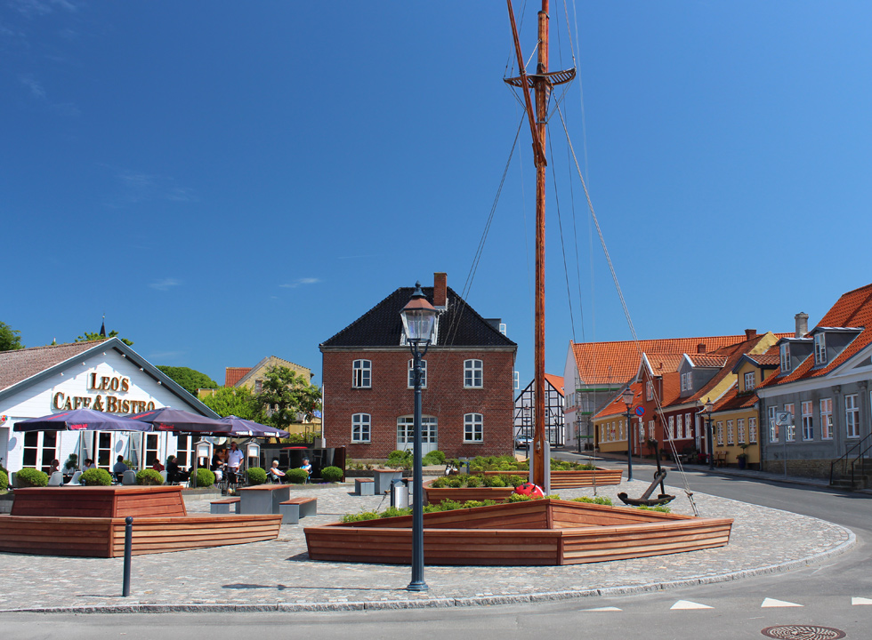 Cosy square and colourful houses by the channel in Bogense