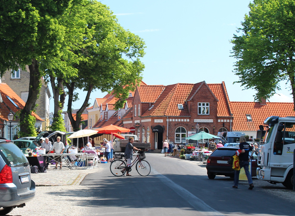 Market under the high trees in the centre of Bogense