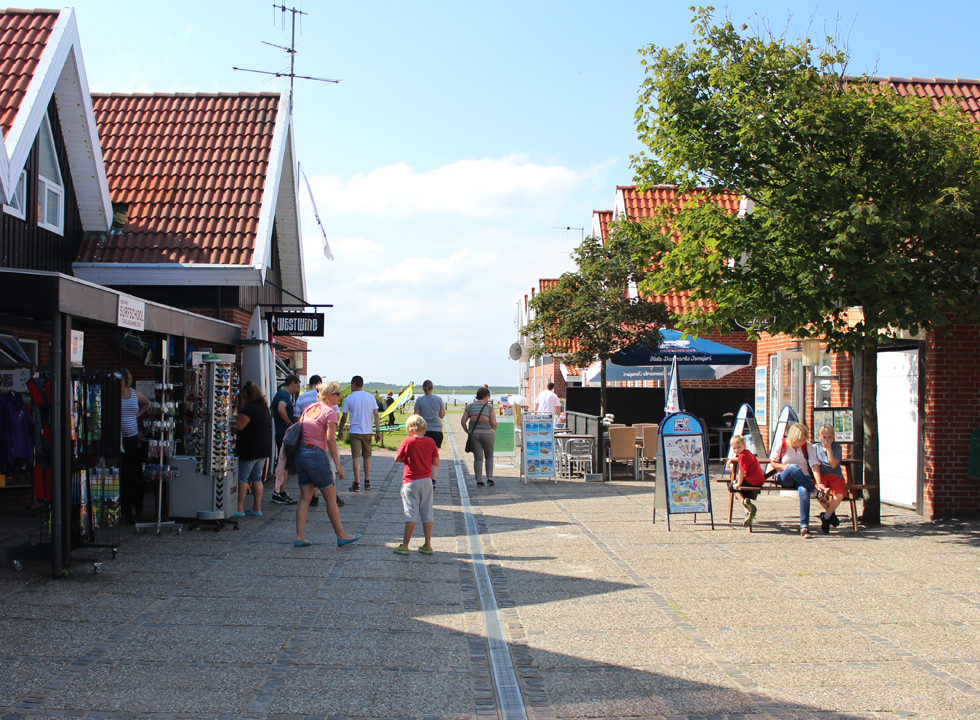 The small cosy pedestrian street with shops, ice cream stalls and eateries in Bork Havn