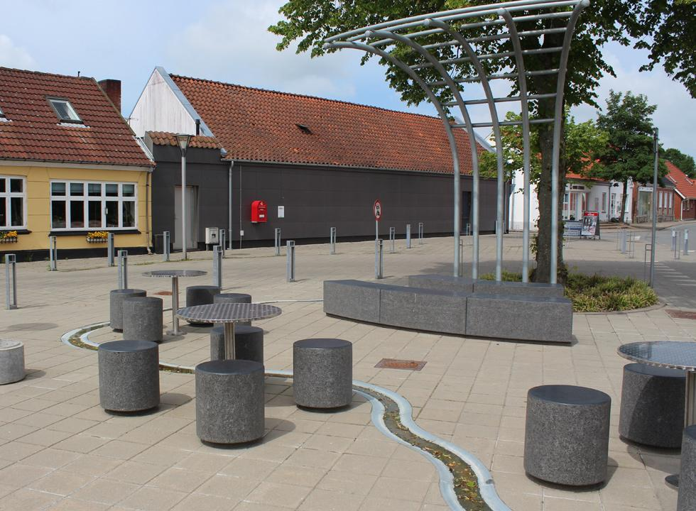 Square with seats and water art in Borris