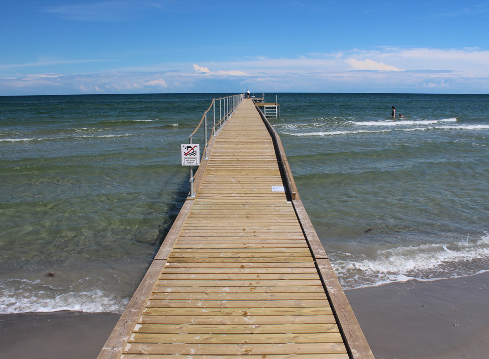 Long bathing jetty with more stairs down to the water in the holiday area Bratten