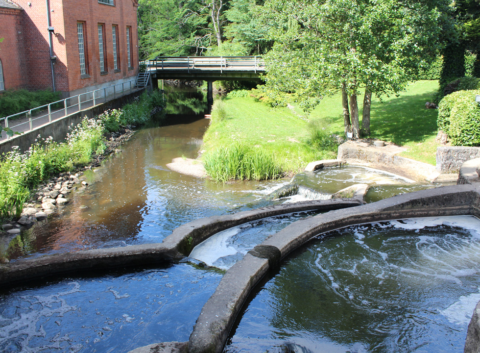 View of the fish ladder and the stream Brende Møllebæk from the bridge, leading over the stream