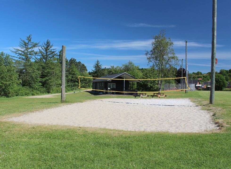 Volleyball net on the green spaces behind the lakeside bath Bryrup Søbad