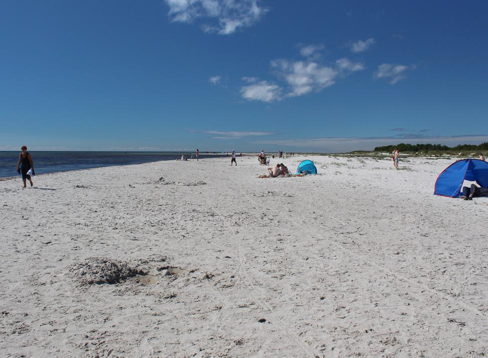Relaxation on the wide sandy beach in Dueodde