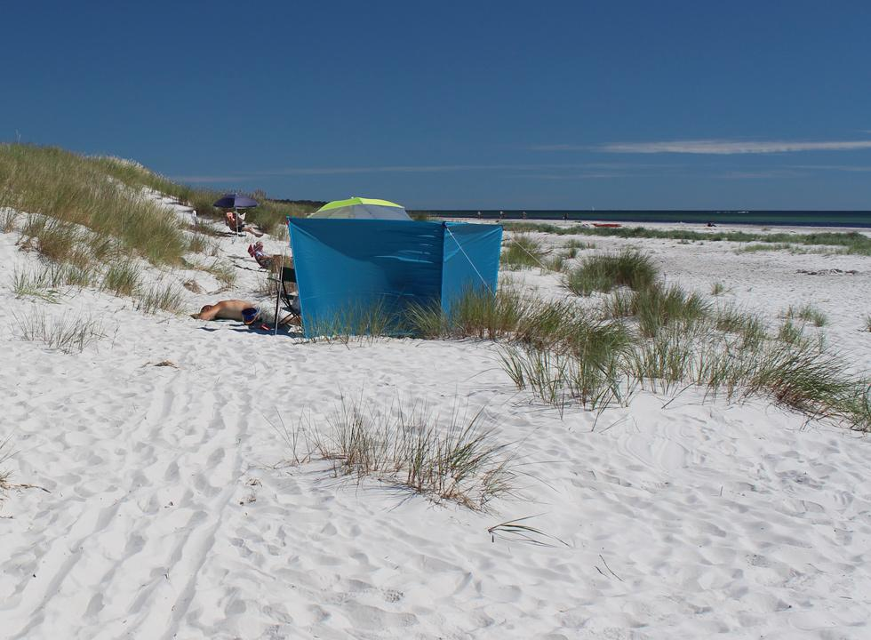 Relaxation in the white sand on the beach of Dueodde