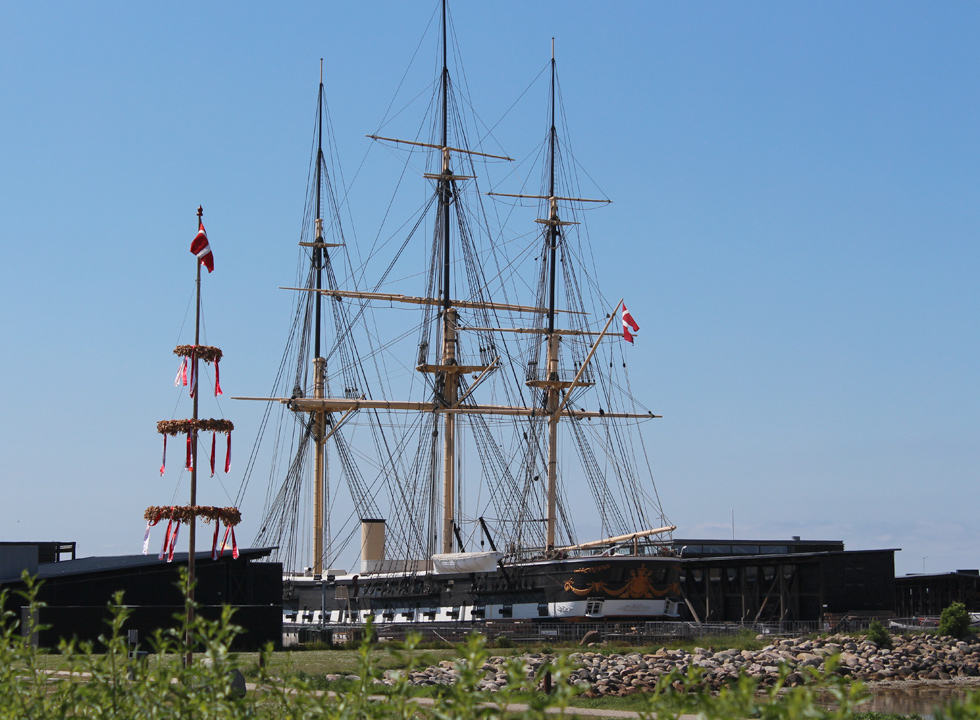 Enjoy the sight of the world's longest wooden ship, Fregatten Jylland, in Ebeltoft