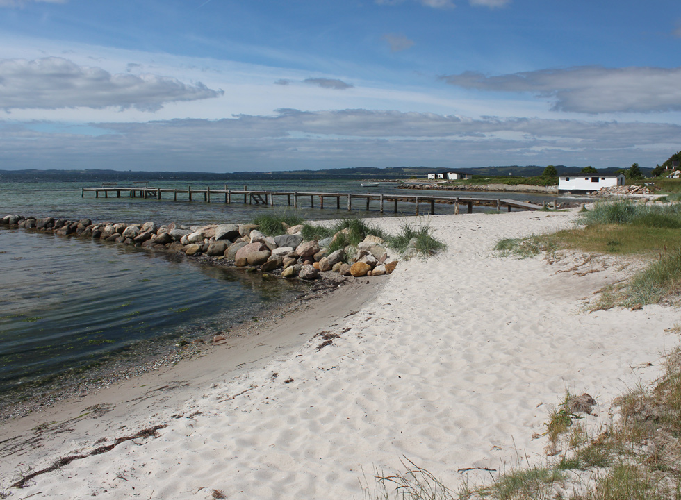 Fine bathing beach with bathing jetty below the holiday homes in Egsmark Strand