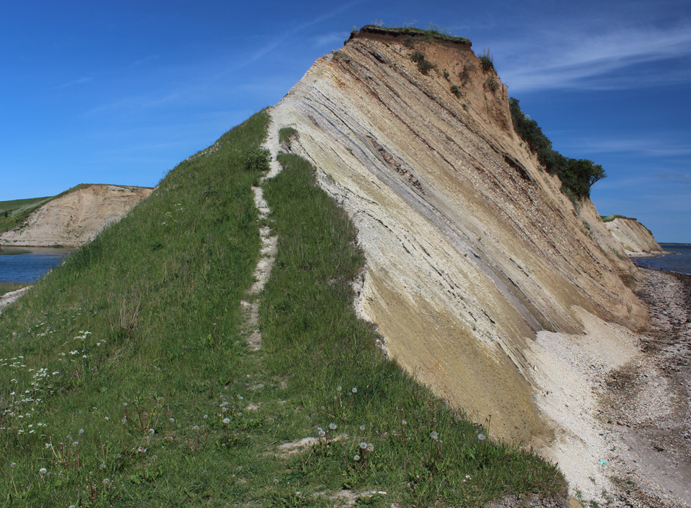 The high and steep molar clay cliff by the shore in Ejerslev, Mors