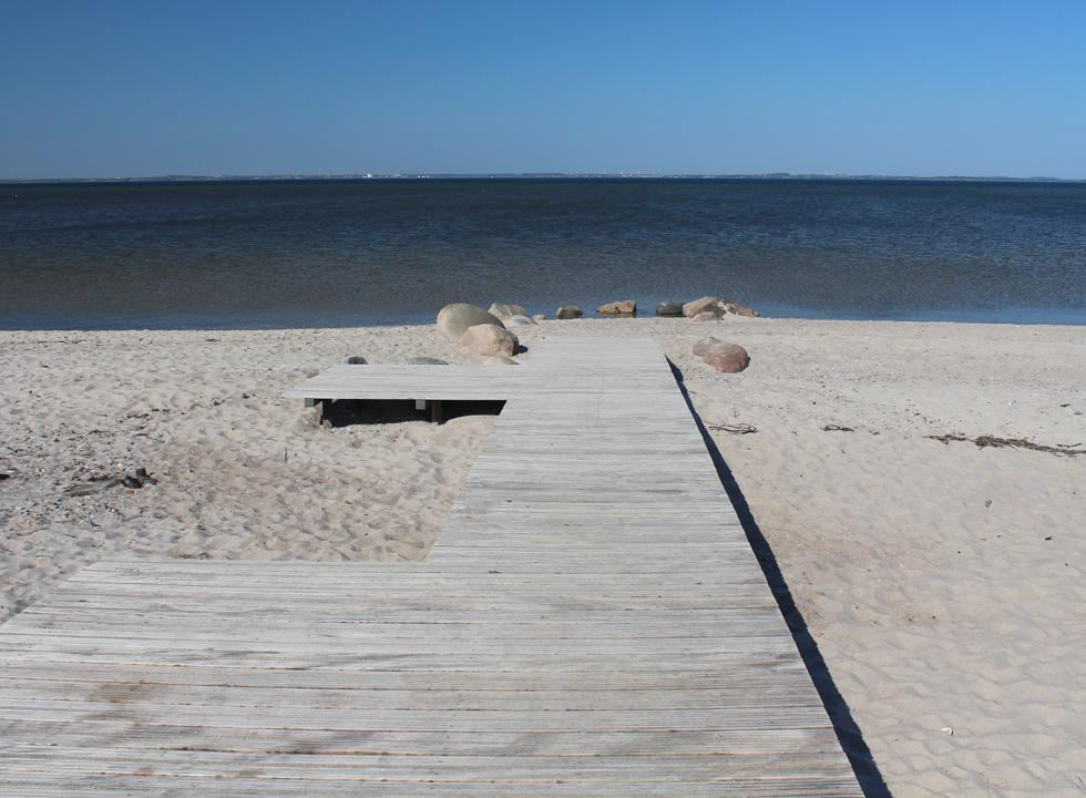View of the Limfjord from the wooden platform on the sandy beach in Ejsingholm