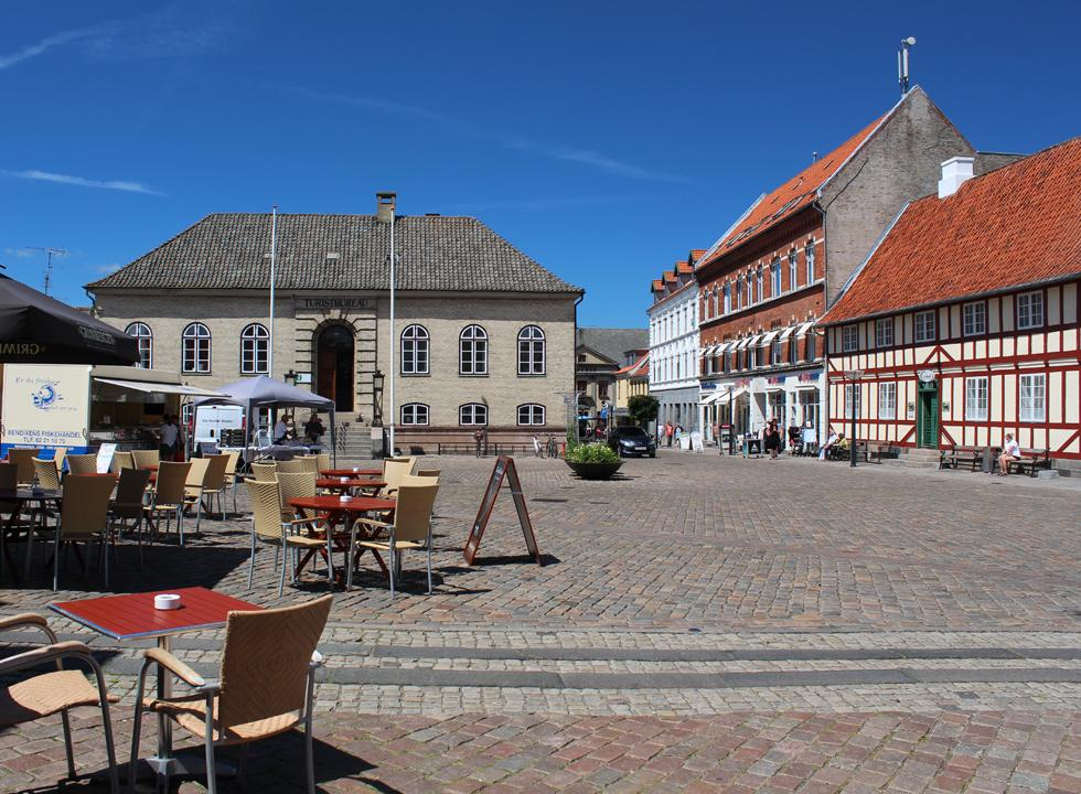 The square in Fåborg with cafés, shops and beautiful old houses
