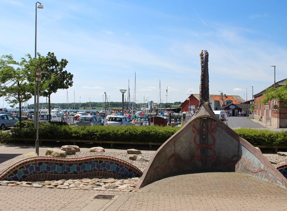 Ship sculpture on a square by the harbour in Fåborg