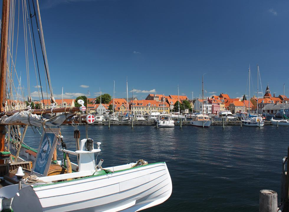 View of the harbour and the beautiful and colourful houses along the water in Fåborg