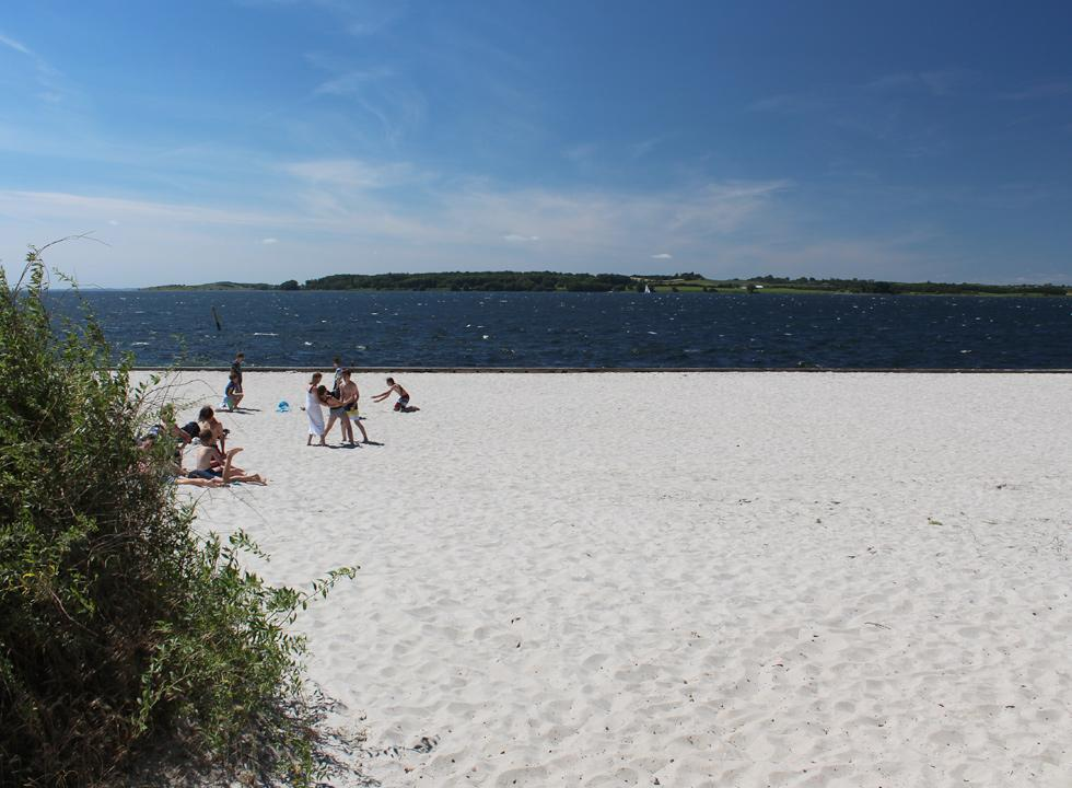 Klinten strand is a wide beach with white sand and a view of Fåborg Fjord