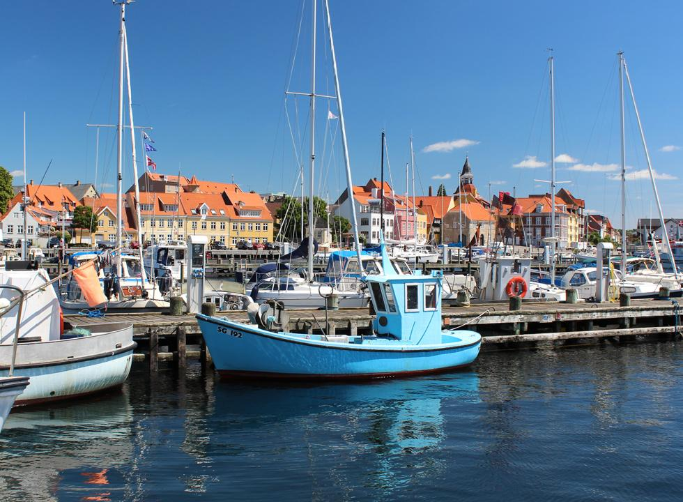 Fishing vessels and pleasure boats side by side in the harbour of Fåborg