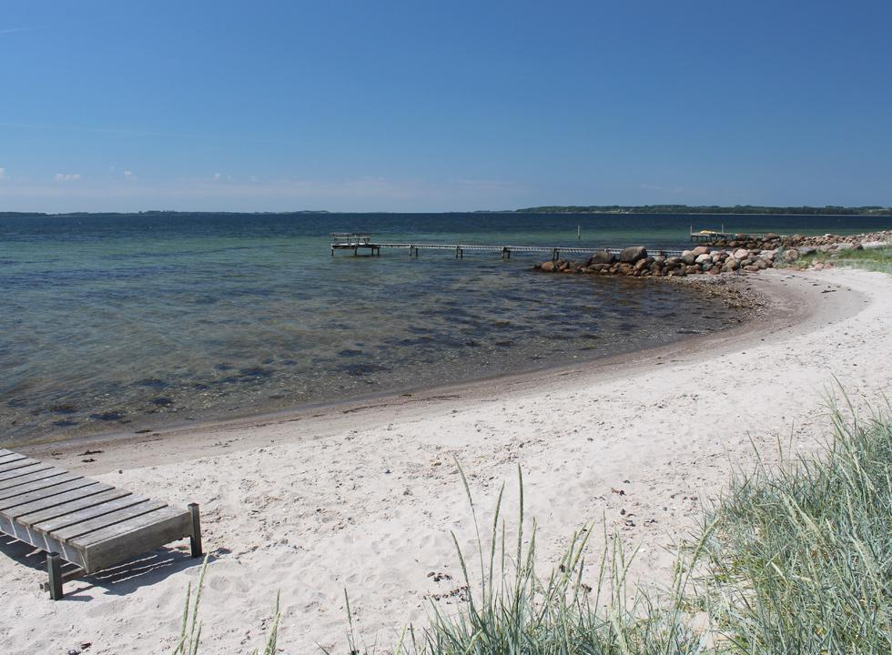 Lovely sandy beach by the holiday home area, to the west of the marina in Falsled