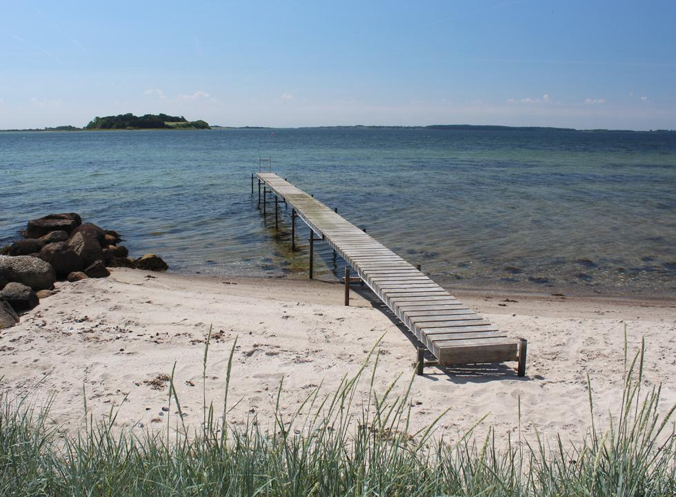Long bathing jetty by the bathing beach in the western part of Falsled