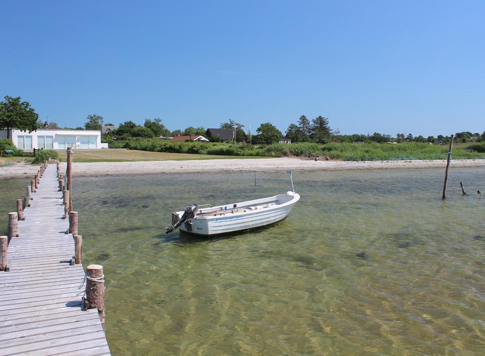 Boat on the clear water by the beach in the holiday area Falsled