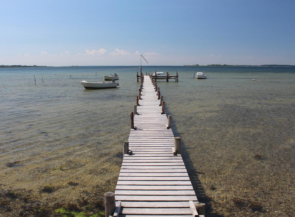 Long bathing jetty by the clear bathing water in Falsled in the South Funen Archipelage