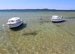 Small boats on the clear water in the holiday area Falsled