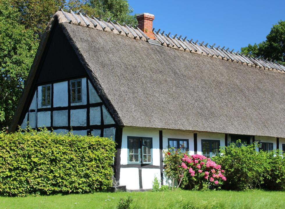 One of the many idyllic half-timbered houses with thatched roof on Fejø