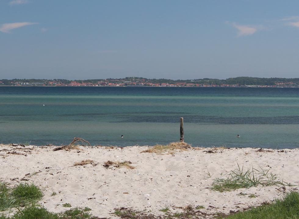 From the beach of Femmøller you can enjoy the view of Ebeltoft and the frigate Fregatten Jylland