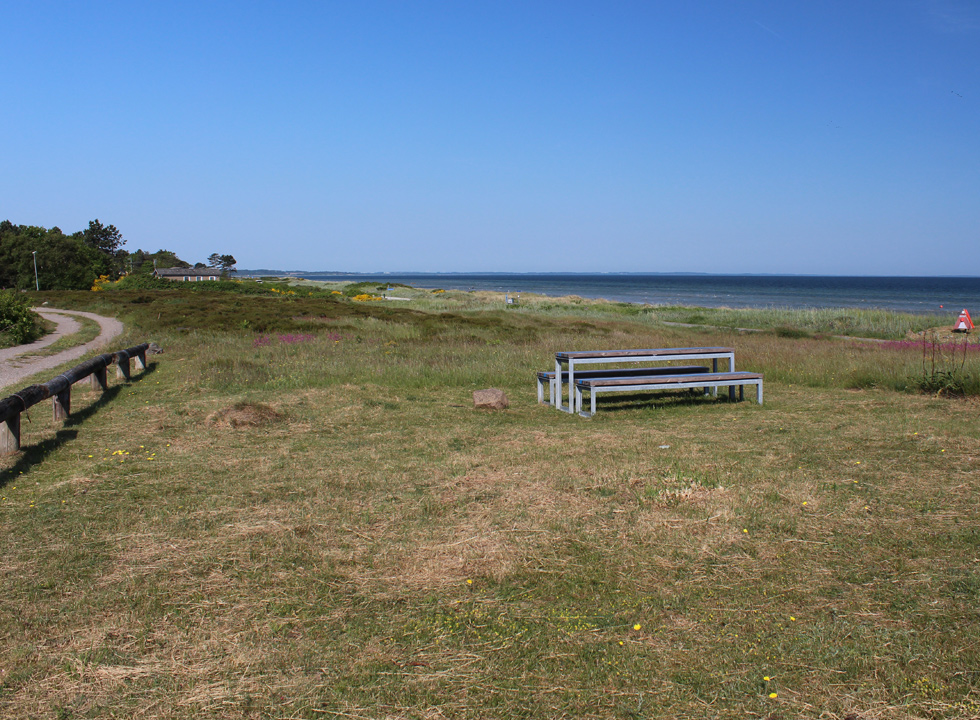Picnic area behind the beach in the holiday home area of Fjellerup Strand