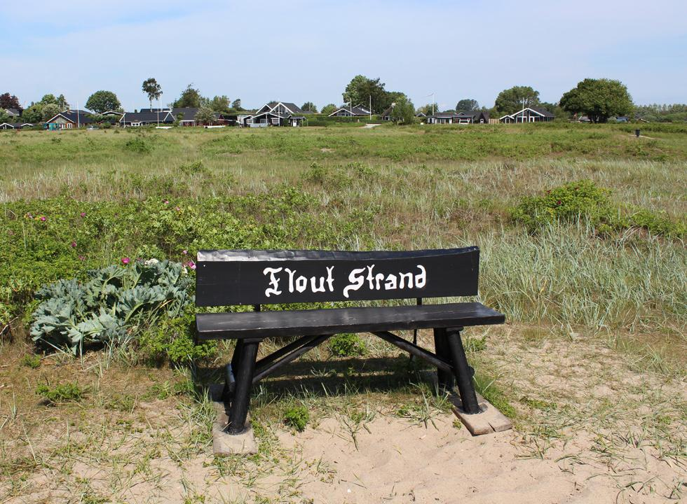 View bench by the bathing beach in the holiday home area Flovt