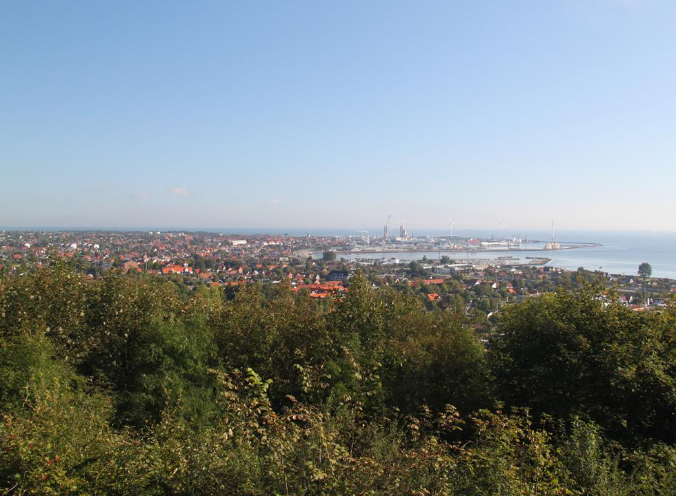 Great view of the ferry harbour and the red roofs of the town from the hill Pikkerbakken in Frederikshavn