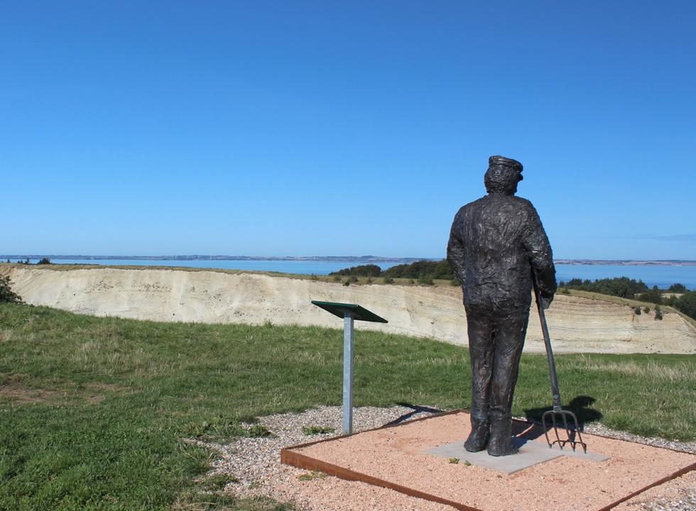The sculpture, Molermanden, overlooking the largest moler pit on Fur
