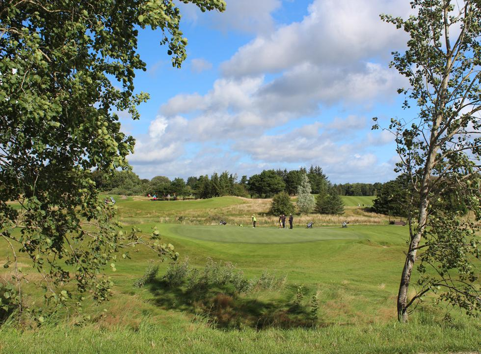 Golfers on the course at Himmerland Golf Klub in Gatten